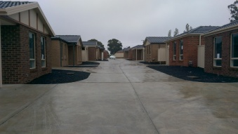A view up the driveway towards the front of the block
